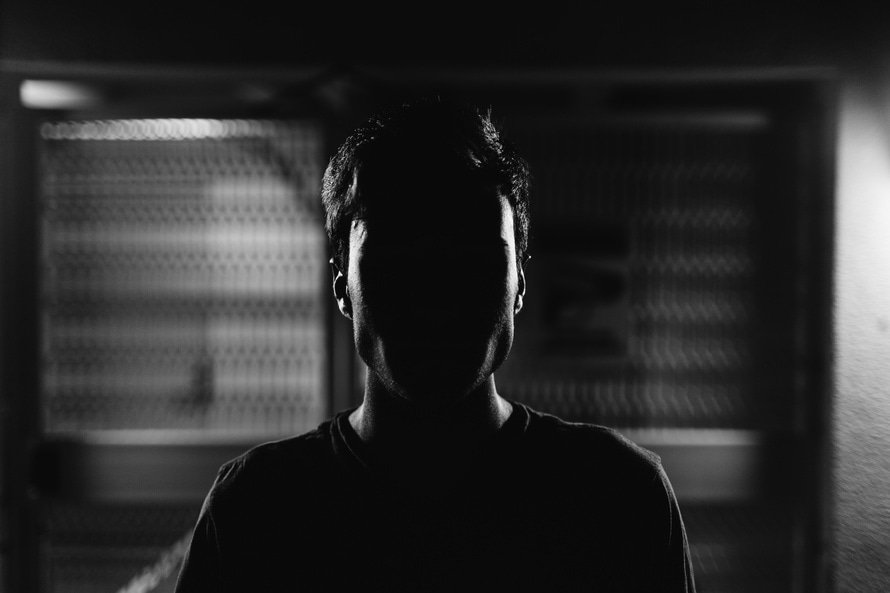 Anonymous face in the shadows