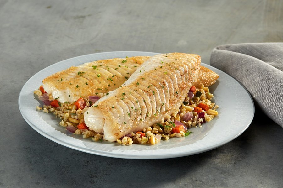 Tilapia fillet served with grains