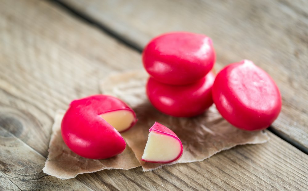 Babybel cheese on wooden table