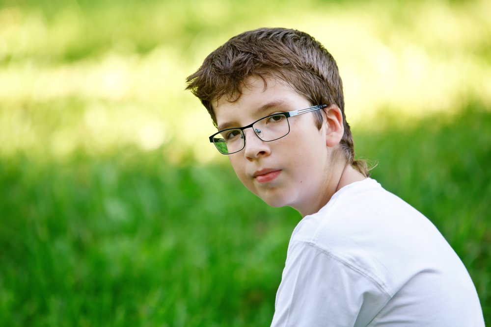Boy Wearing Eye Glasses in Field