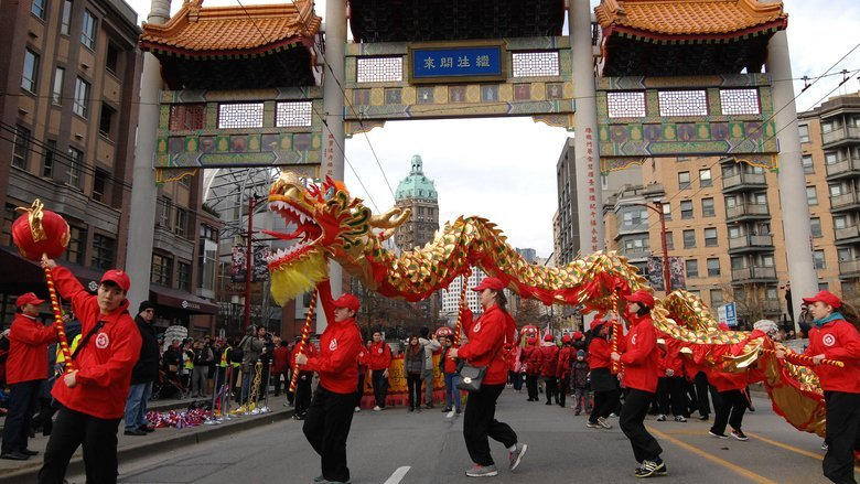 People Holding Dragon During Parade on Pender Street in Vancouver's Chinatown