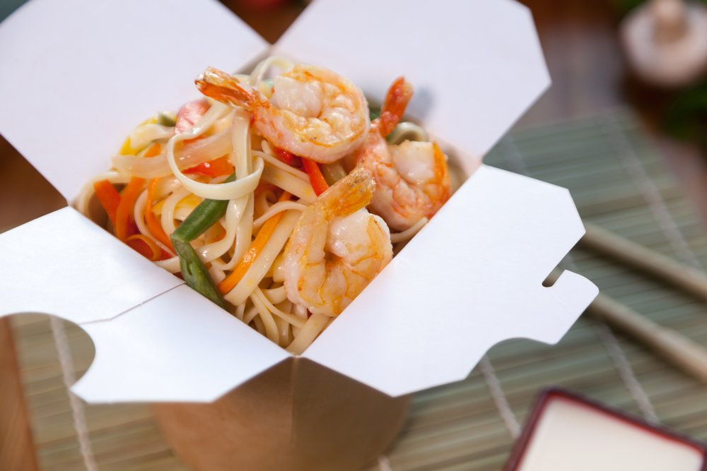 Chinese takeout boxes filled with noodles Foods Impact the Environment