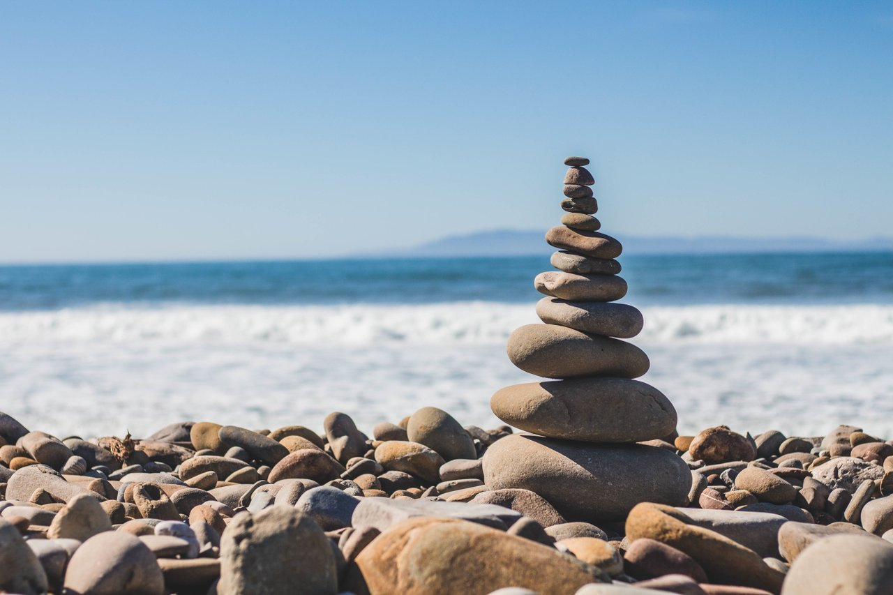 Stack of rocks on a beach illustrating hierarchy