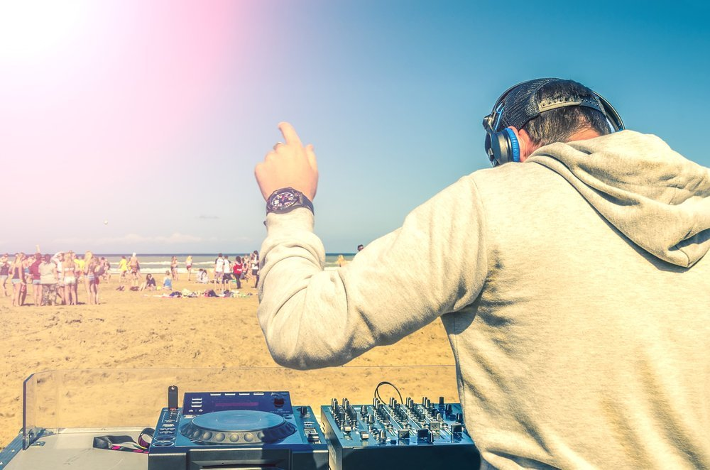 DJ playing music on the beach