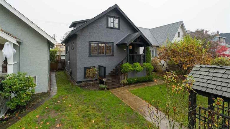 Grey house with black trim for sale on King Edward Ave.