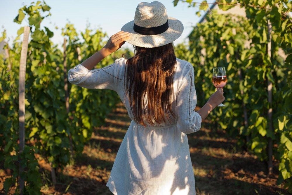 Woman enjoying fine wine at a vineyard