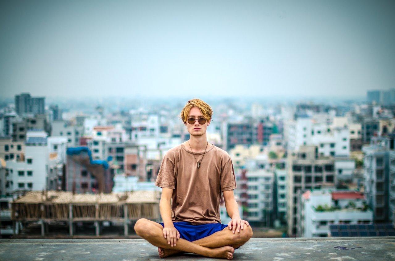 Man doing yoga in urban setting