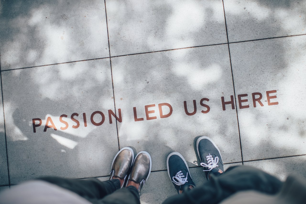 Feet on sidewalk with text