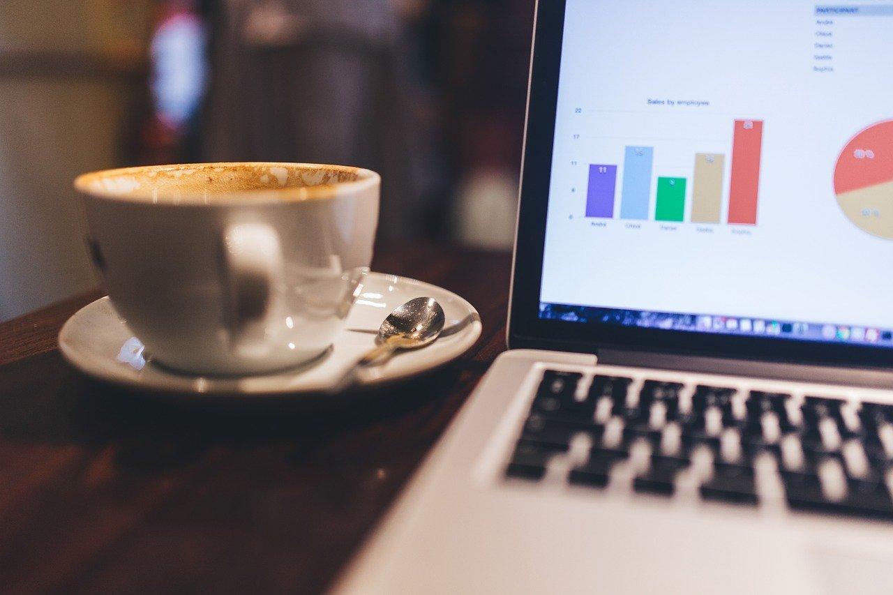 laptop and coffee mug on table