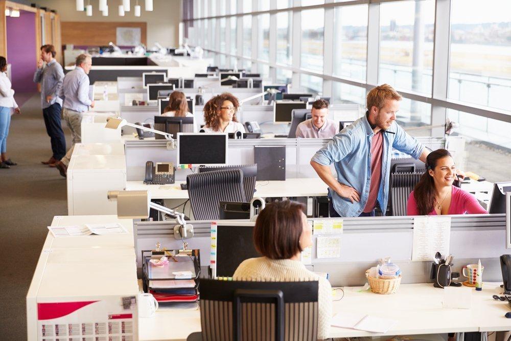 rows of desks in office