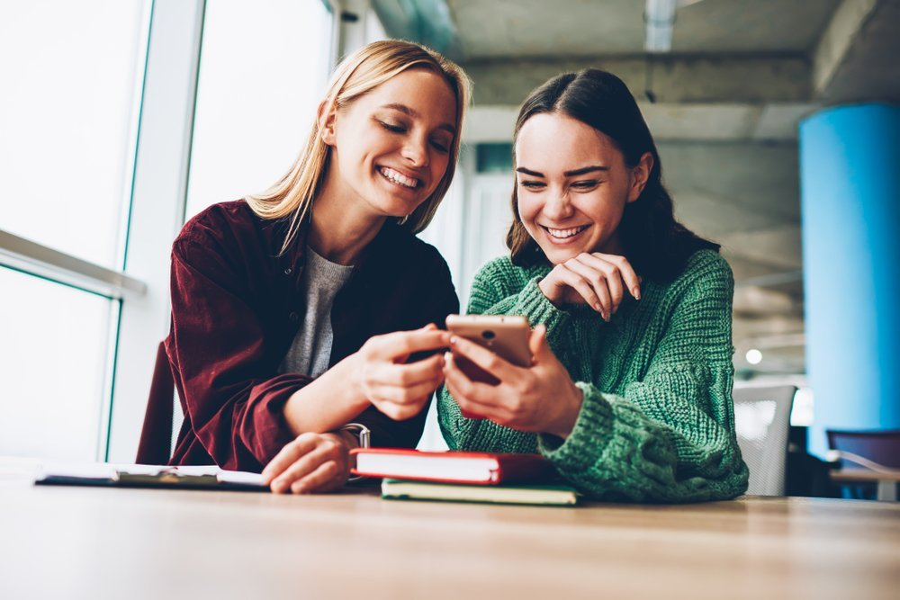 friends laughing with mobile phone
