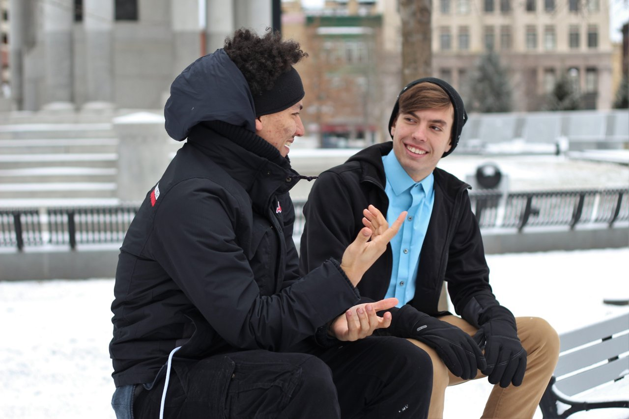 two-guys-friendly-conversation