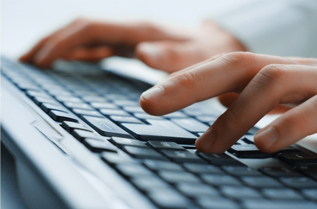 hand typing on computer