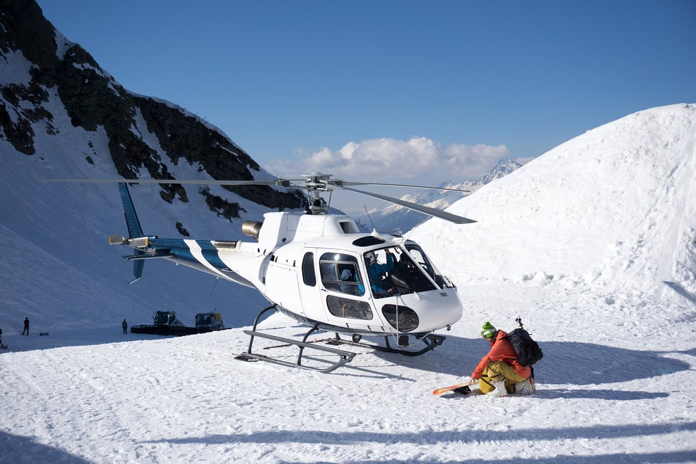 Helicopter and Snowboarder