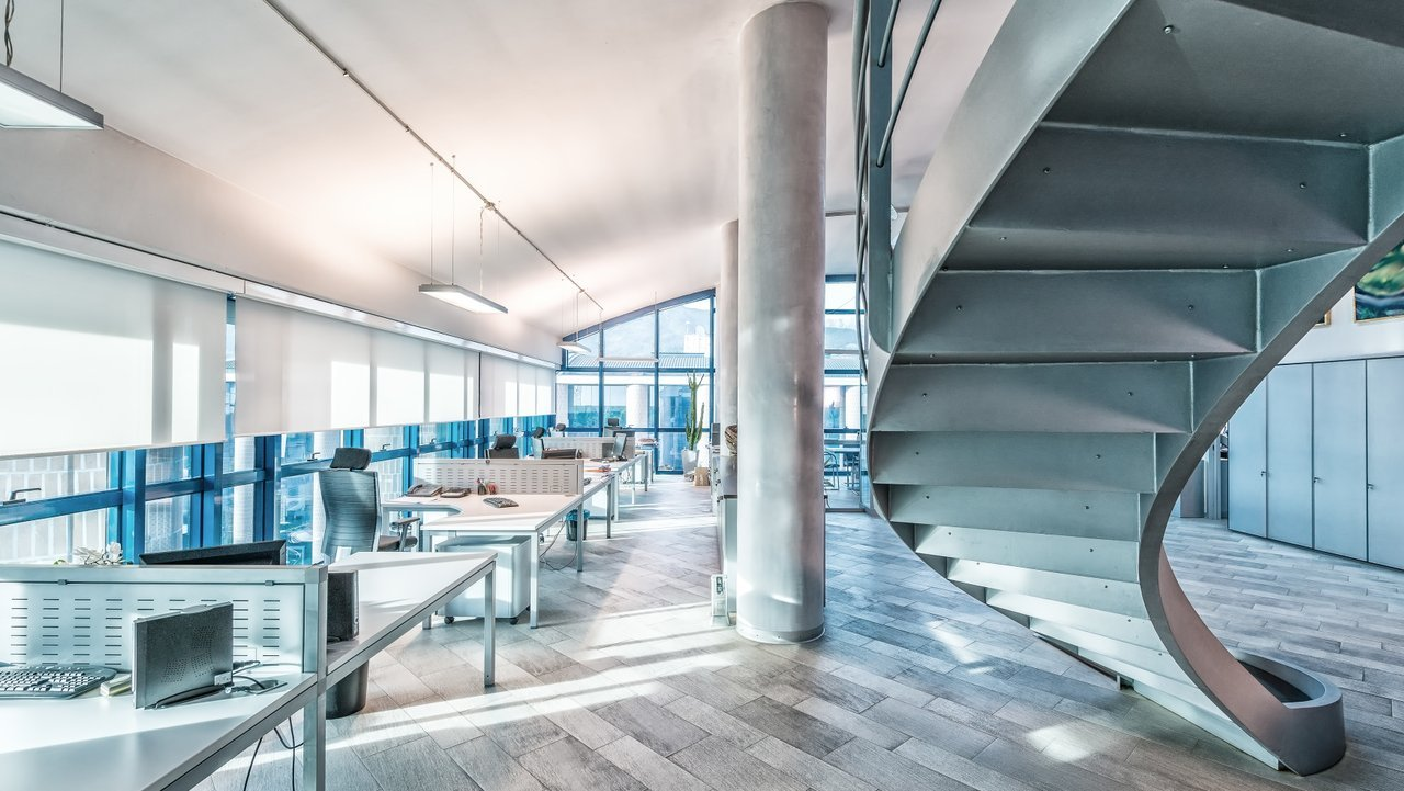 Interior of bright, modern office building with facilities management software
