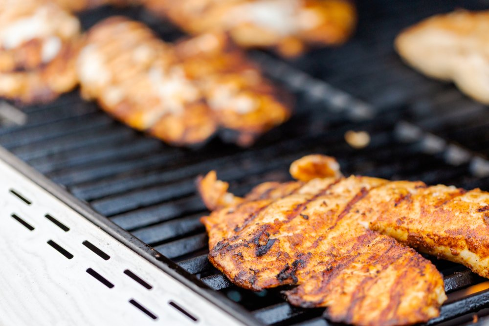 Close up shot of grilled fish on outdoor gas grill