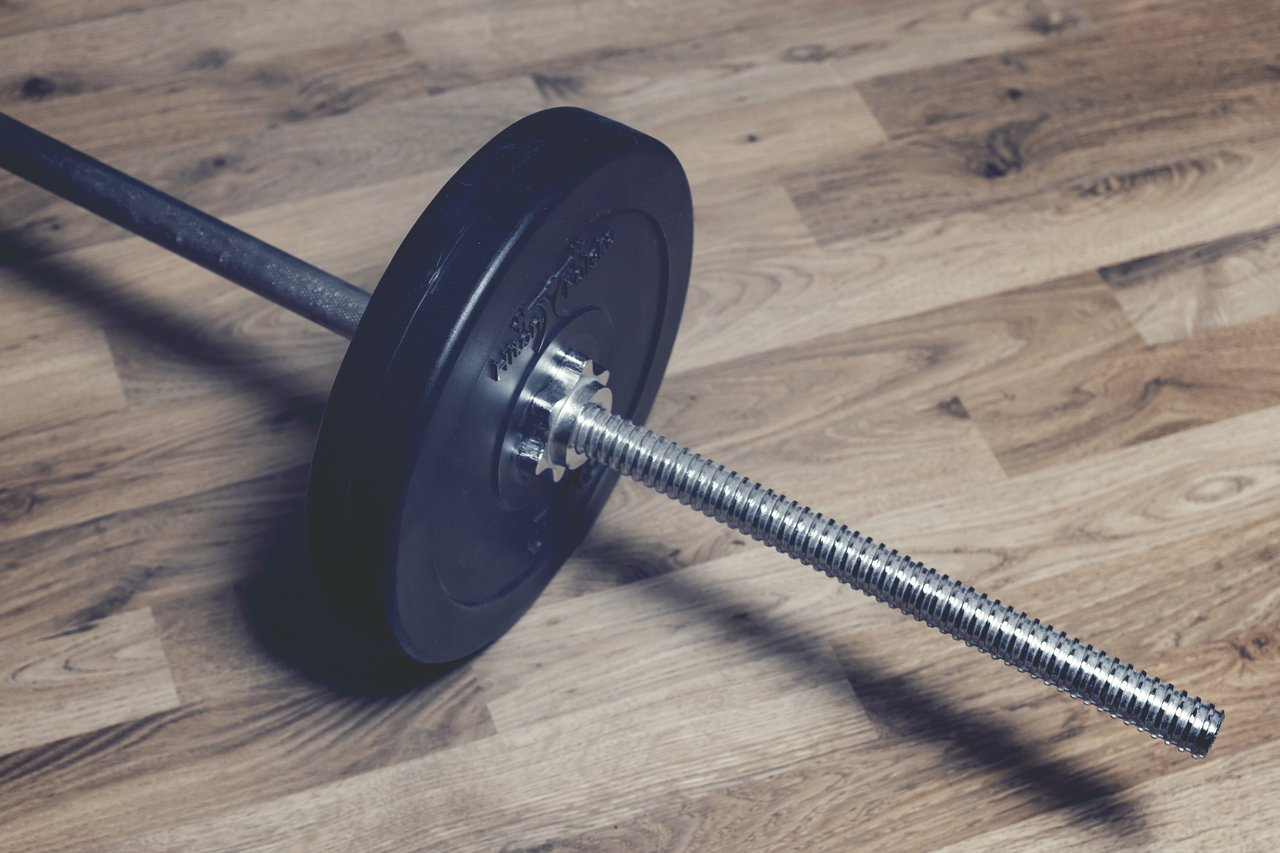 A large barbell with which to stimulate muscle growth.