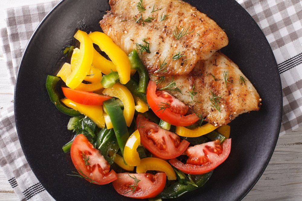Tilapia with peppers and tomatoes