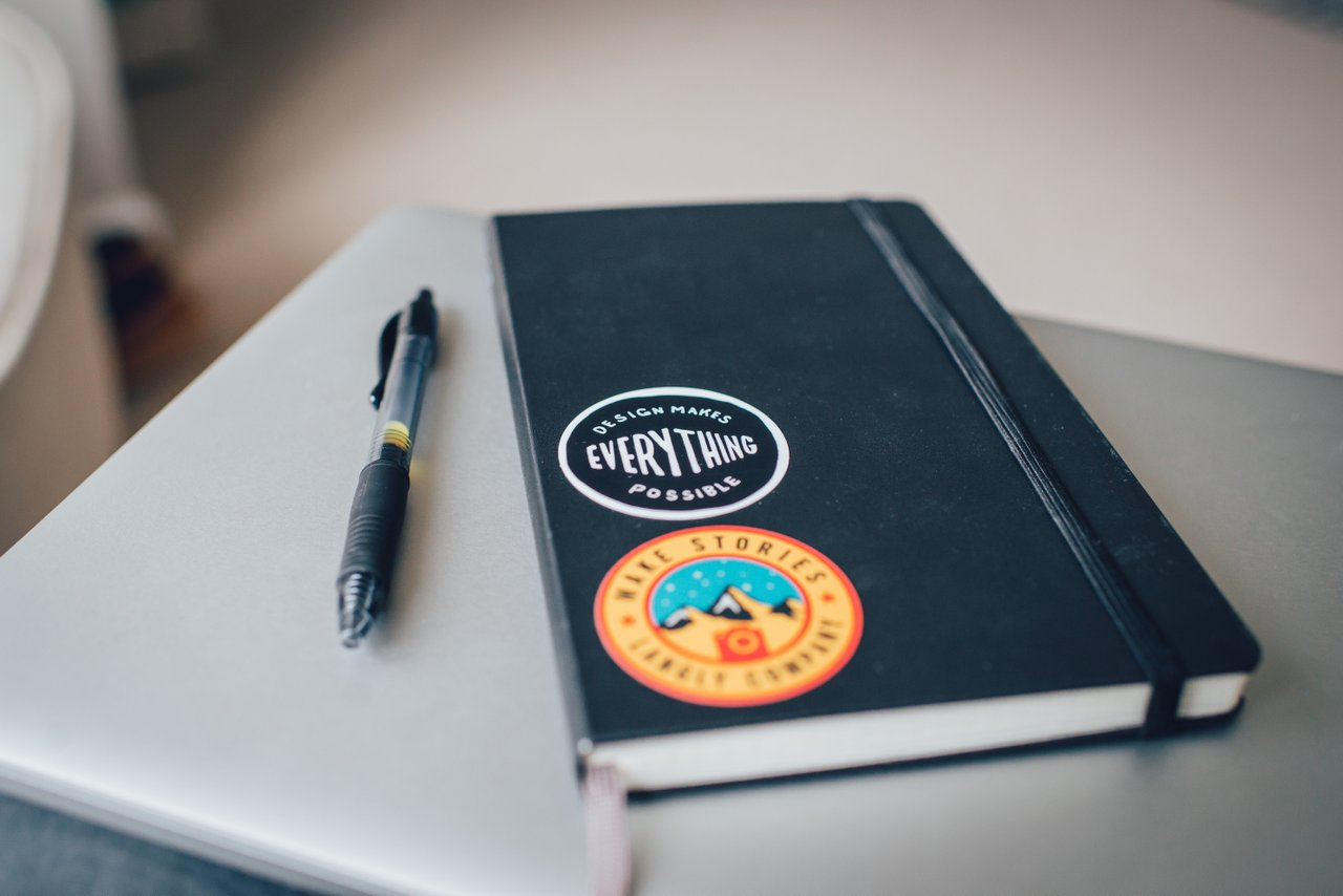 notebook and pen on desk