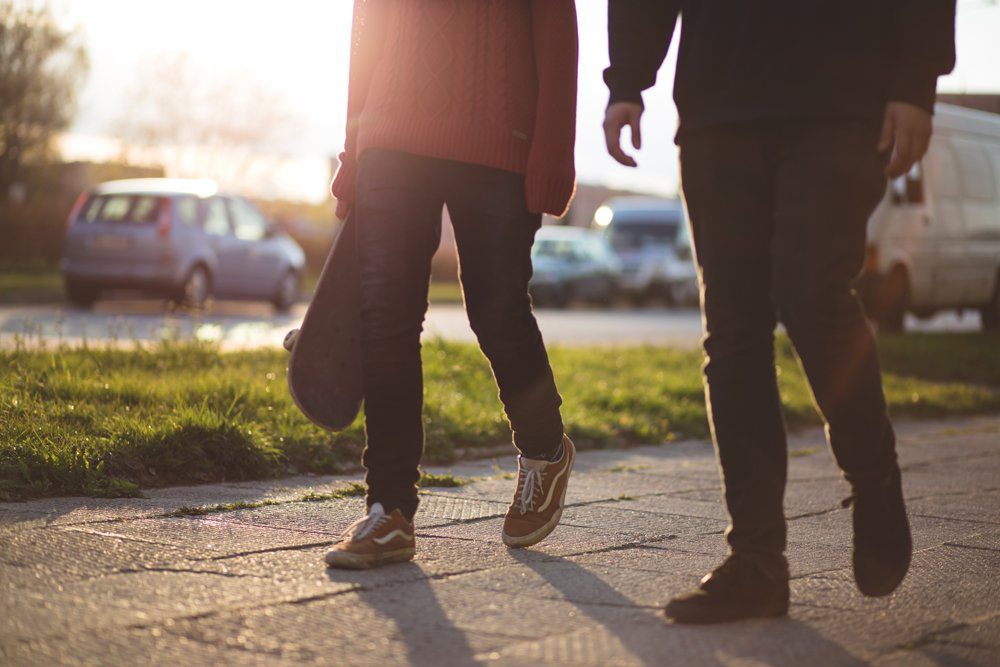 teens walking on sidewalk