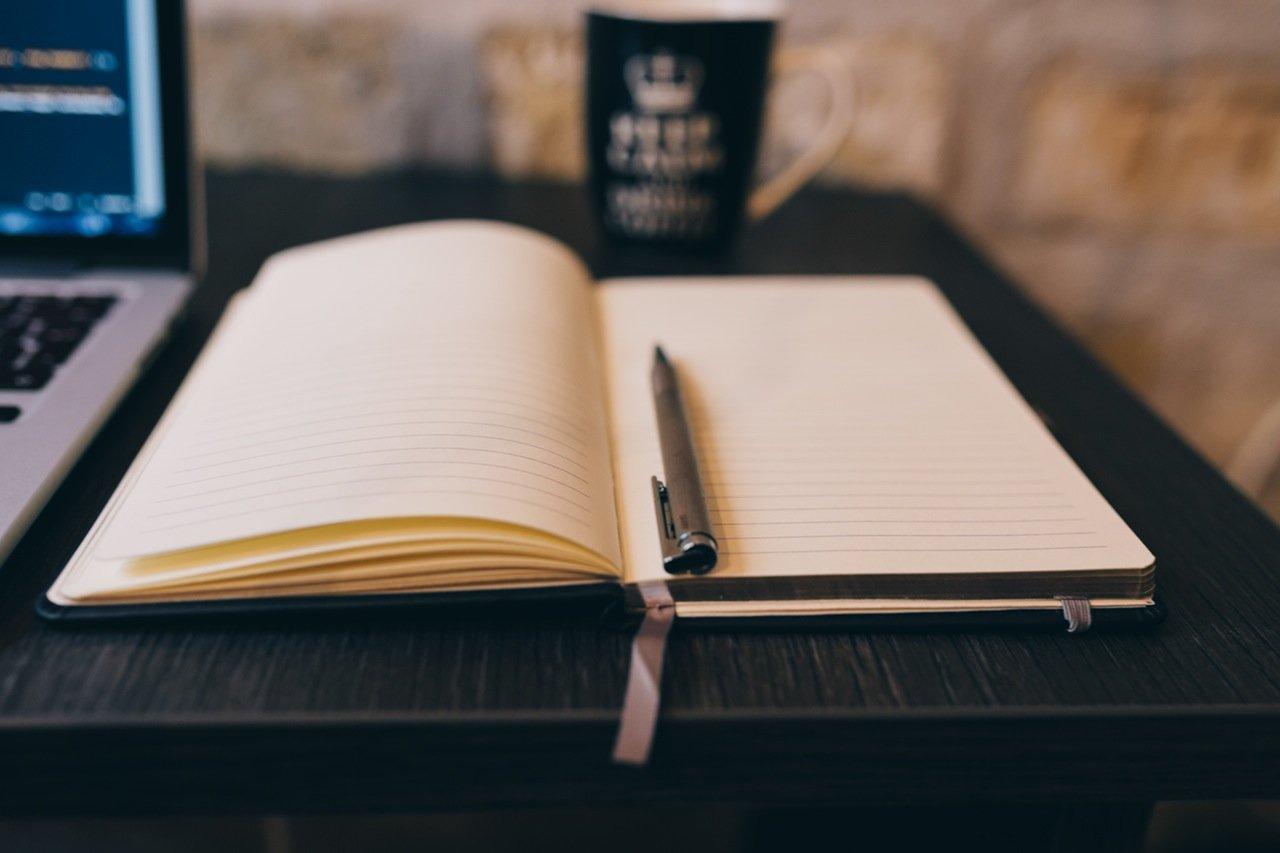 open workbook and pen