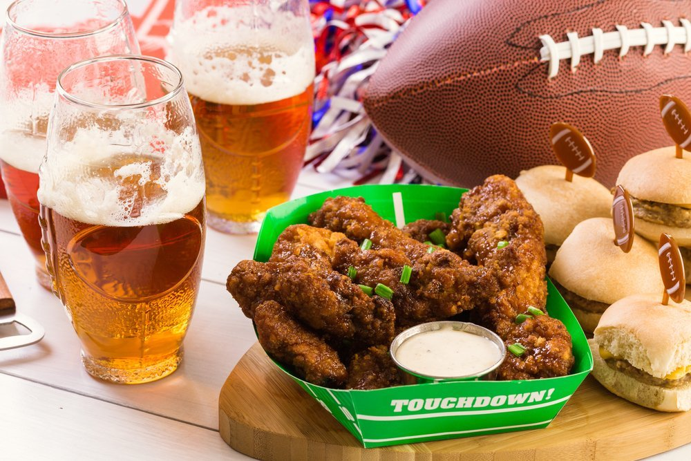 Beer, chicken wings, mini hamburgers and a football