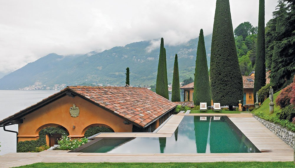 The pool of Mediterranean-looking villa faces out onto Lake Como in Italy.