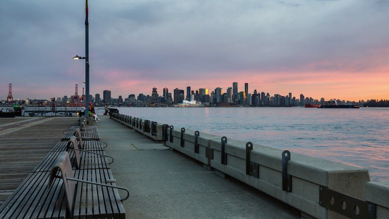 Lonsdale Dock and view of sunset over Vancouver, BC