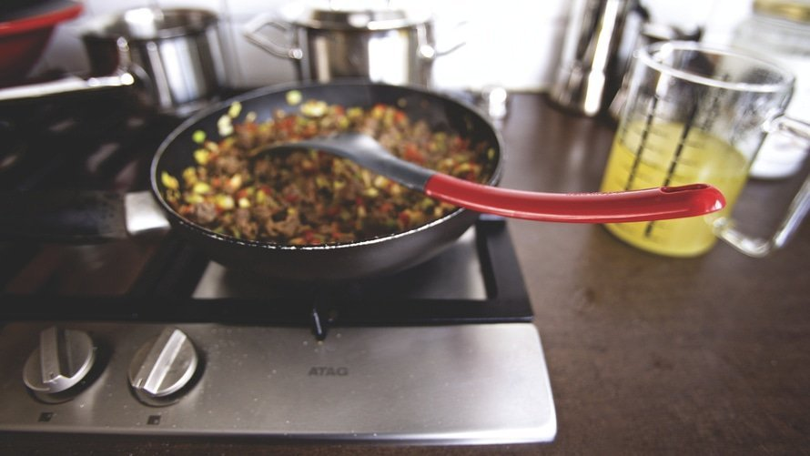 Pan of foods cooking on a stove