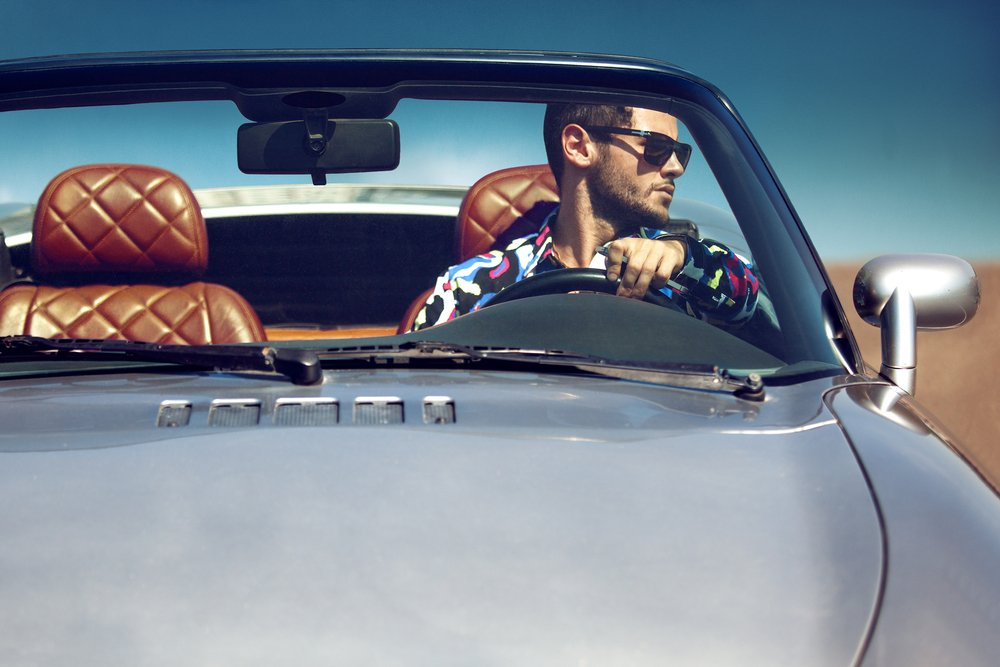 Man Driving Fancy Car