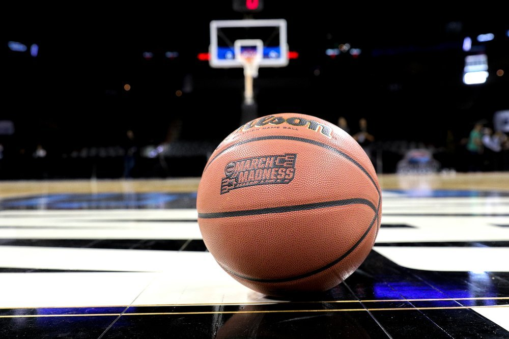 March Madness printed on basketball