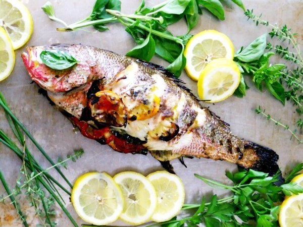 Whole roast Tilapia with lemon and herbs Mediterranean diet dinner