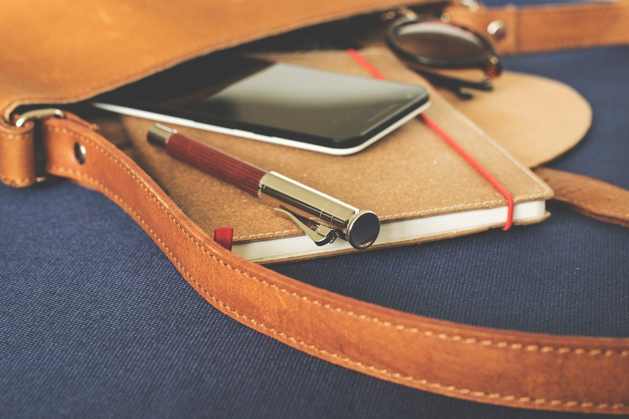 bag with phone, notebook and pen