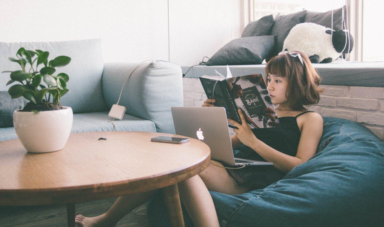 office employee reading in a break area