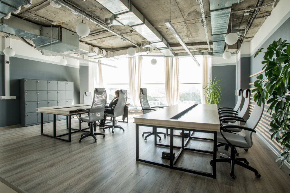 Industrial open office space layout with plants