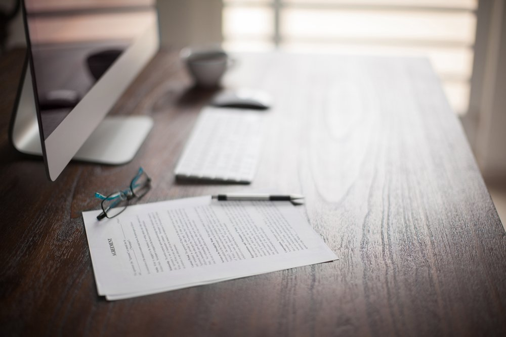 contracts and pen on table
