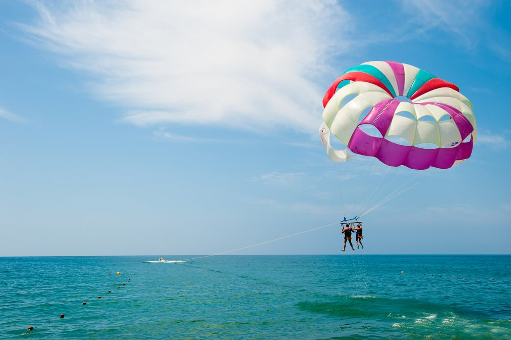 a couple parasailing on vacation