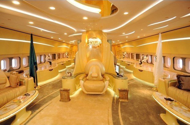 Golden interior of Prince Alwaleed's private jet featuring gold cushioned chair