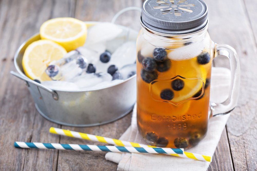 Iced blueberry lemon tea in a mason jar
