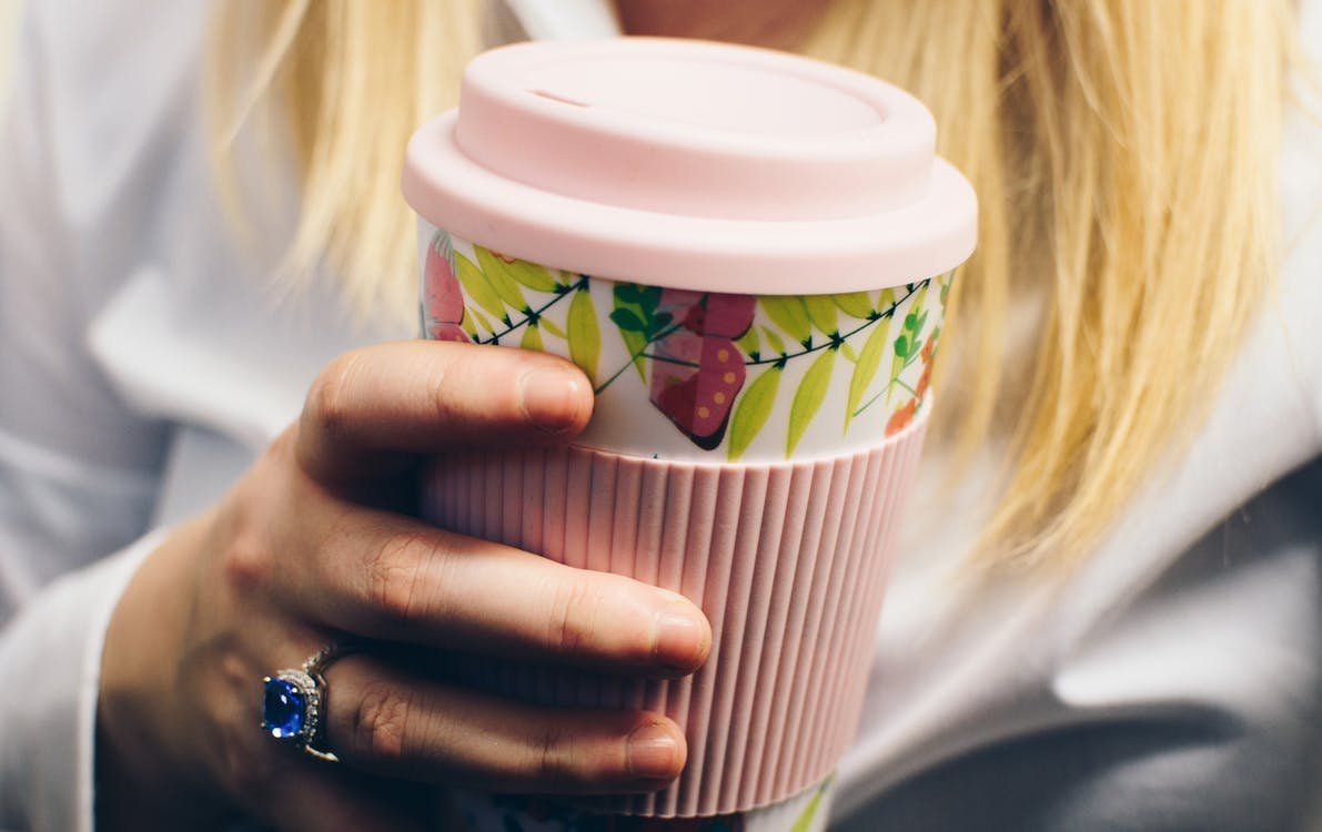 Woman using resuseable coffee cup