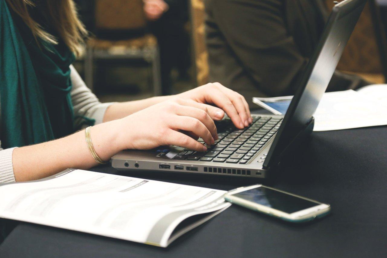 office employee working on laptop