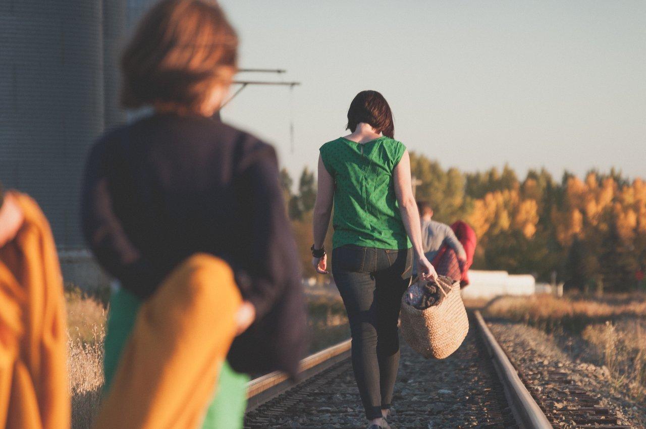 Family walking on railroad tracks