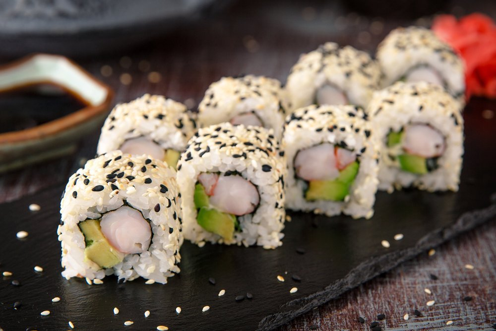 Sushi roll with prawn, avocado, cream cheese, sesame