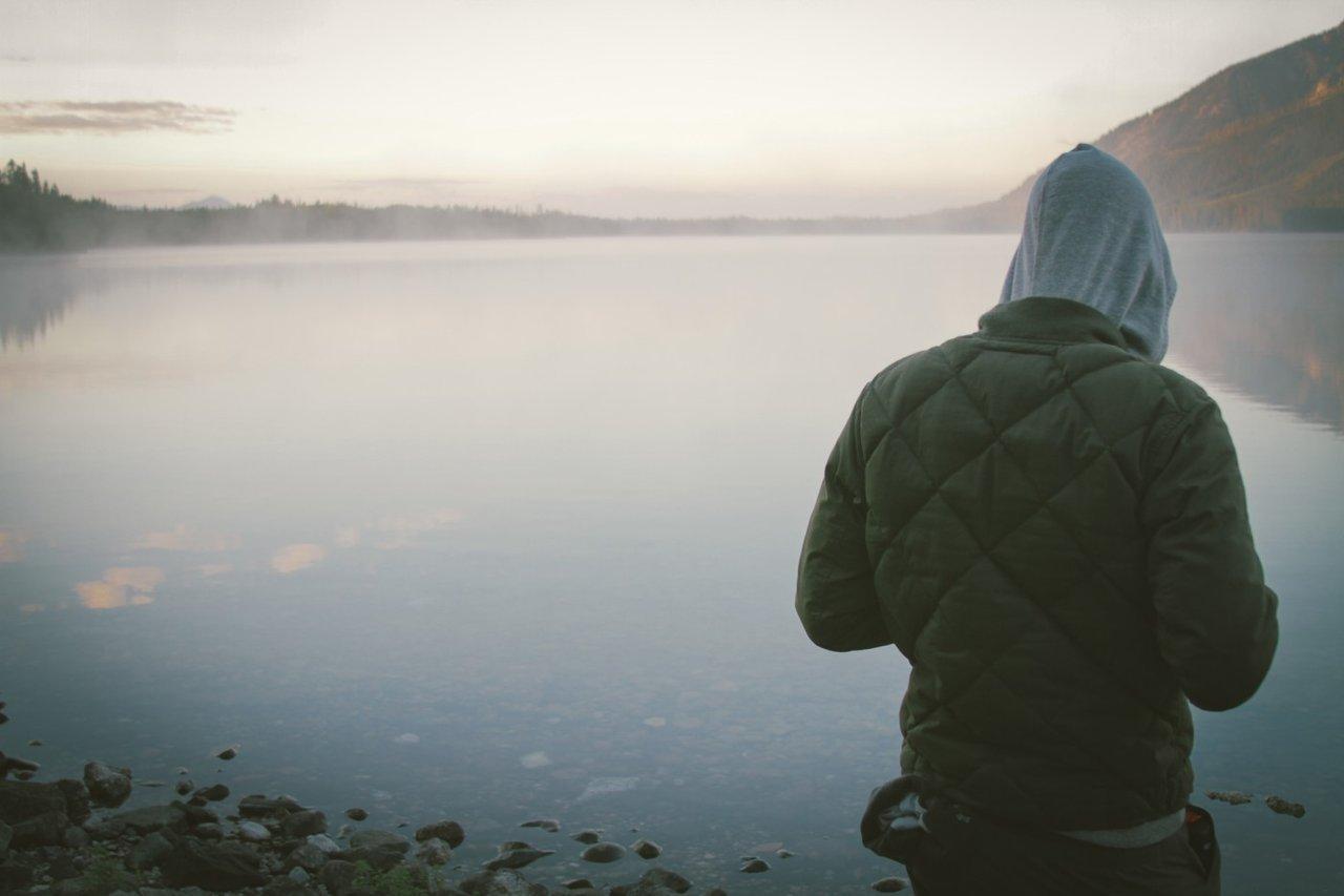 Teen looking over water