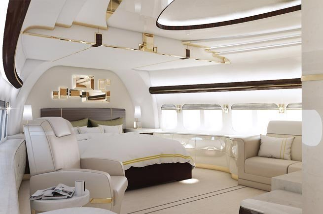 Interior shot of all-white luxurious bedroom of Boeing 747-8 VIP