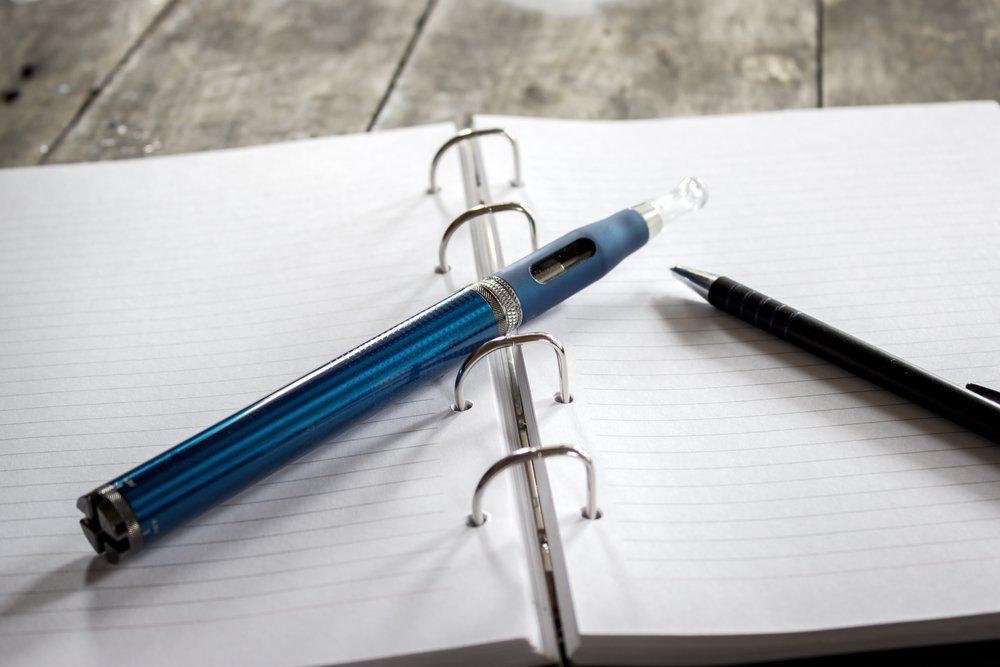 vape pen and notebook