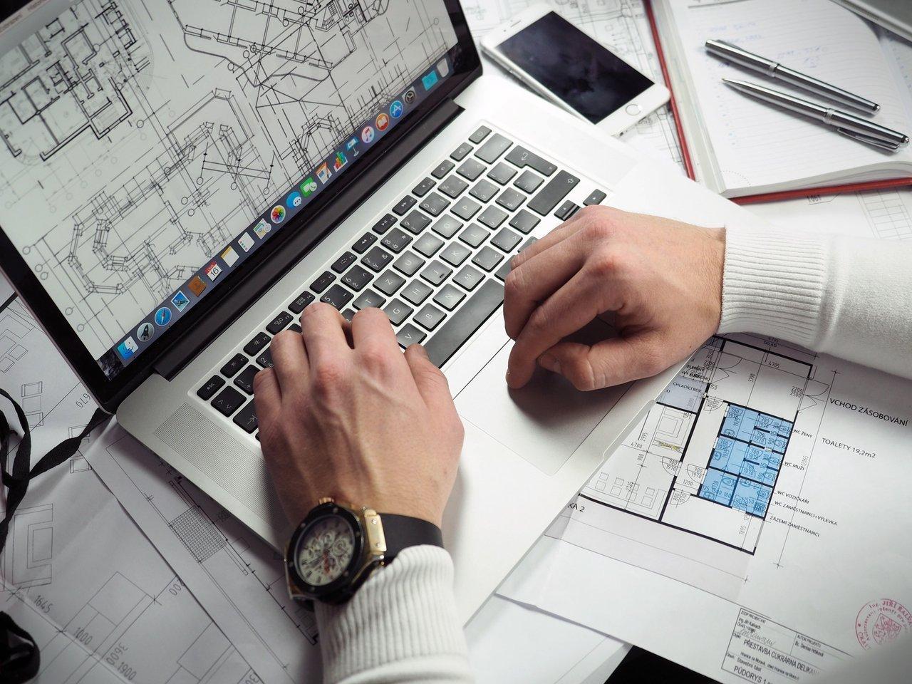 facility manager looking at visual data on computer