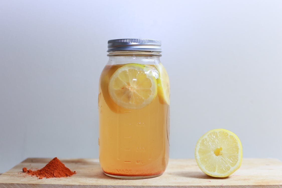 Glass jar with lemon cayenne water