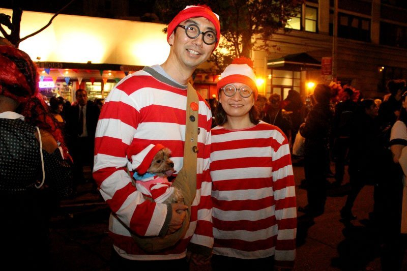 Couple and dog in Where's Waldo costumes
