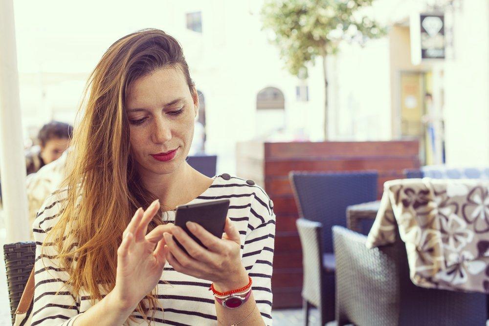 Girl-with-long-hair-staring-at-phone